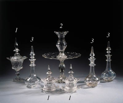 three cut-glass decanters and