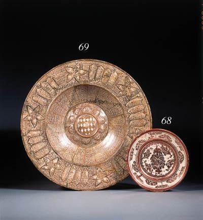 a hispano-moresque copper-lustre plate