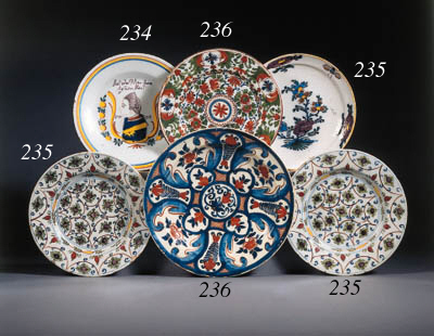 three dutch delft dishes and a