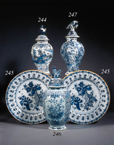 three dutch delft blue and white baluster vases and covers