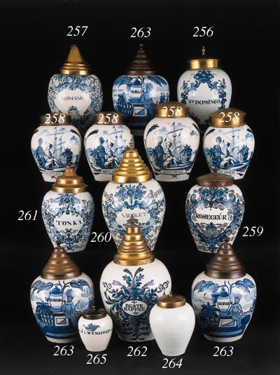 a dutch delft blue and white tobacco jar and copper cover