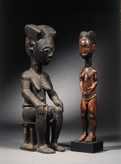 a baule seated female figure