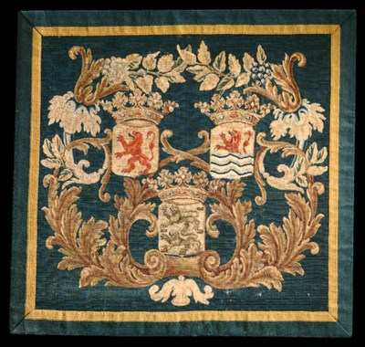 A FLEMISH ARMORIAL TAPESTRY PA