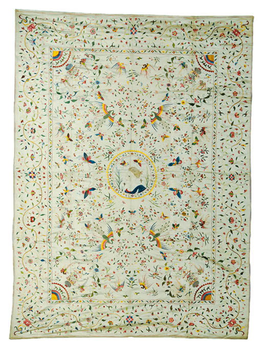 A COVERLET OF IVORY SATIN