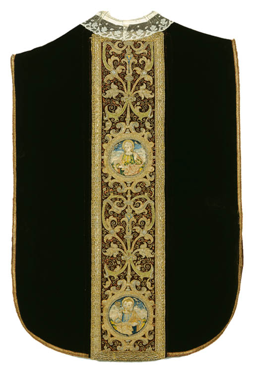 A CHASUBLE OF PLUM COLOURED VE