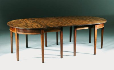 A GEORGE III MAHOGANY DINING-T