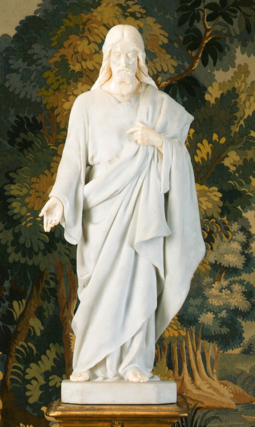 A carved marble and ivory figu