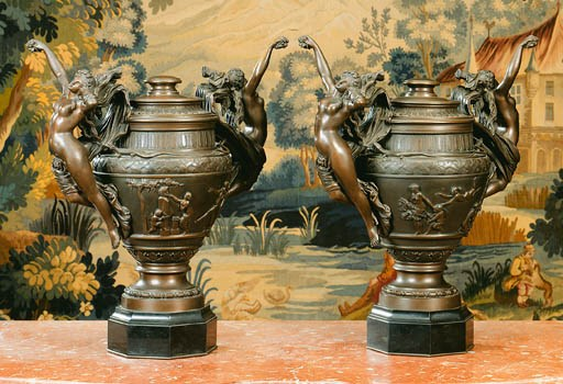 A pair of bronze vases and cov