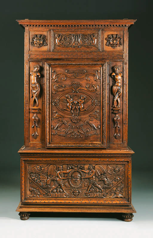 An Continental carved walnut c