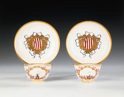 A pair of Meissen armorial tea