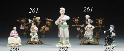 A Meissen figure of a seated D