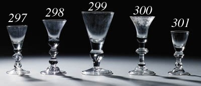 An engraved baluster wine-glas