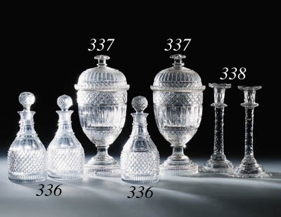 Three cut decanters and stoppe