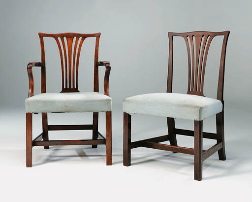 A SET OF FOURTEEN MAHOGANY DINING-CHAIRS