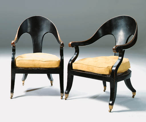 A PAIR OF REGENCY EBONISED AND CANED BERGERES