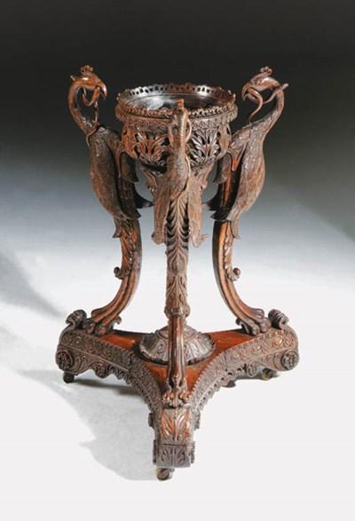 A SINGHALESE PADOUK TRIPOD JAR