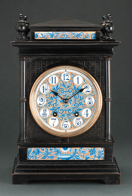 An ebonised and porcelain mant