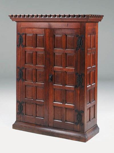 An oak vestment cupboard