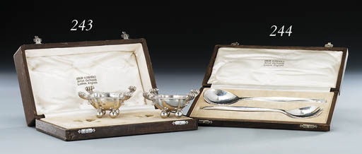 A pair of silver salad servers