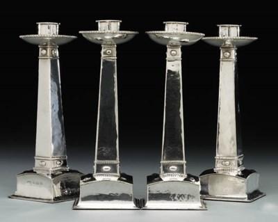 A set of four silver candlesti