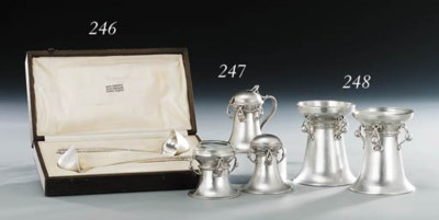 A pair of silver capstan salt
