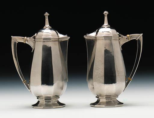 A pair of lidded jugs