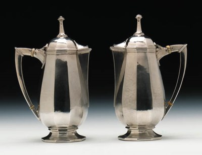 A pair of lidded jugs