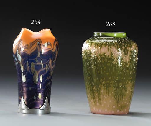 A mounted iridescent glass vas