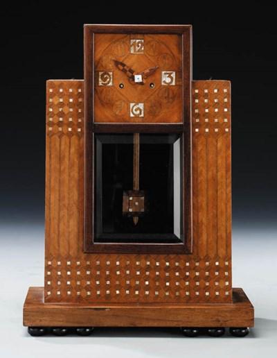 A beechwood mantle clock inlai