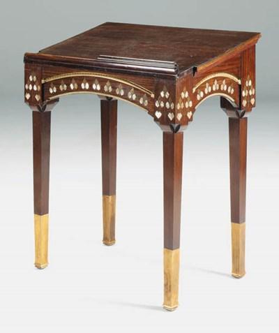 An inlaid mahogany lectern