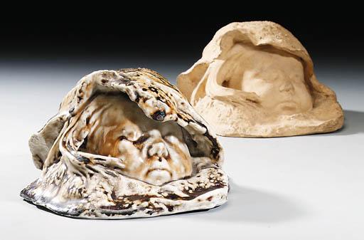 Two Earthenware Masks