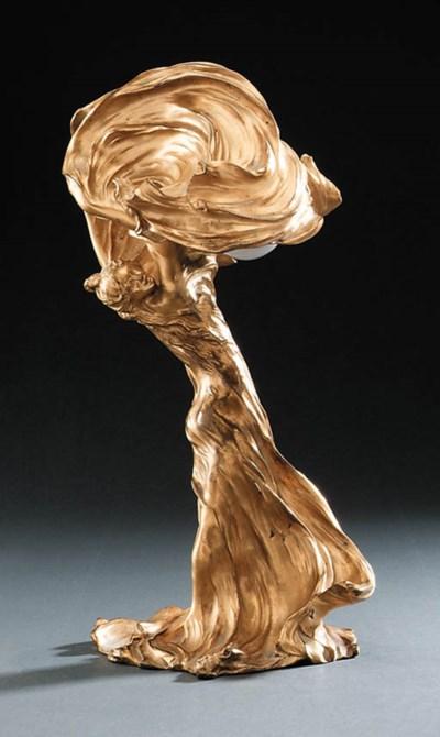 A Gilt-Bronze Figural Lamp of