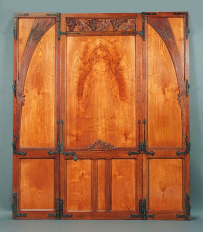 A carved door panel and surrou