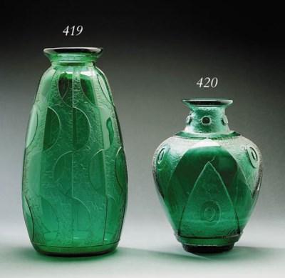 An acid etched glass vase