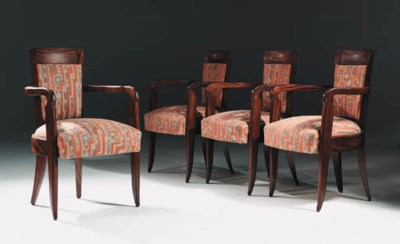 A suite of ten armchairs