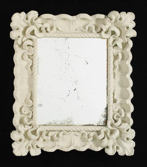 A plaster mirror frame