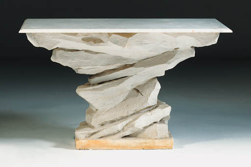 A plaster and marble console t