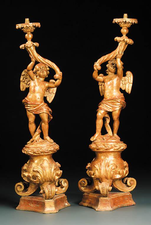 A pair of Italian giltwood tor