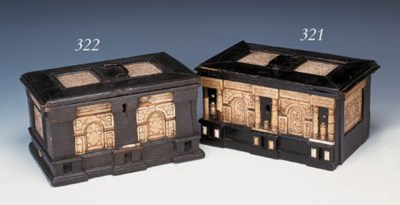 AN EBONISED WOOD AND ALABASTER