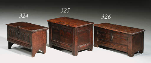 A SMALL OAK BOARDED CHEST