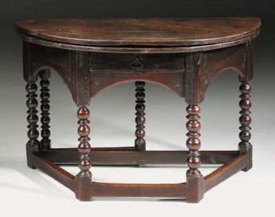 AN OAK FOLDING TABLE