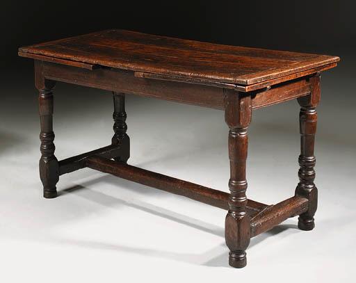 AN OAK DRAW-LEAF TABLE