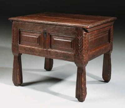 AN OAK COUNTER TABLE