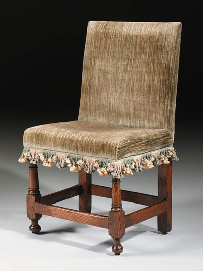 AN OAK FRAMED CHAIR
