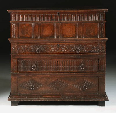 AN OAK CHEST WITH DRAWERS