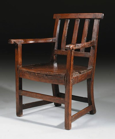 A YEW-WOOD PRIMITIVE ARMCHAIR