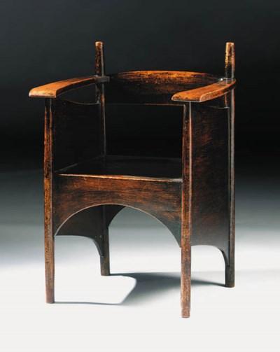 A dark stained oak armchair