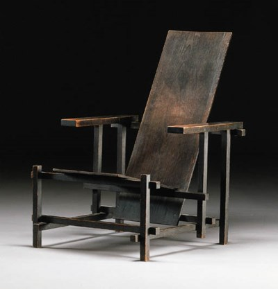 A dark stained armchair