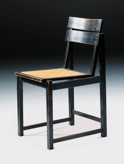 An ebonised and caned sidechai