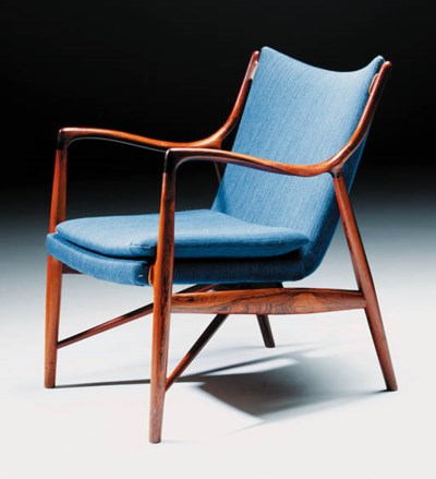 An upholstered rosewood armcha